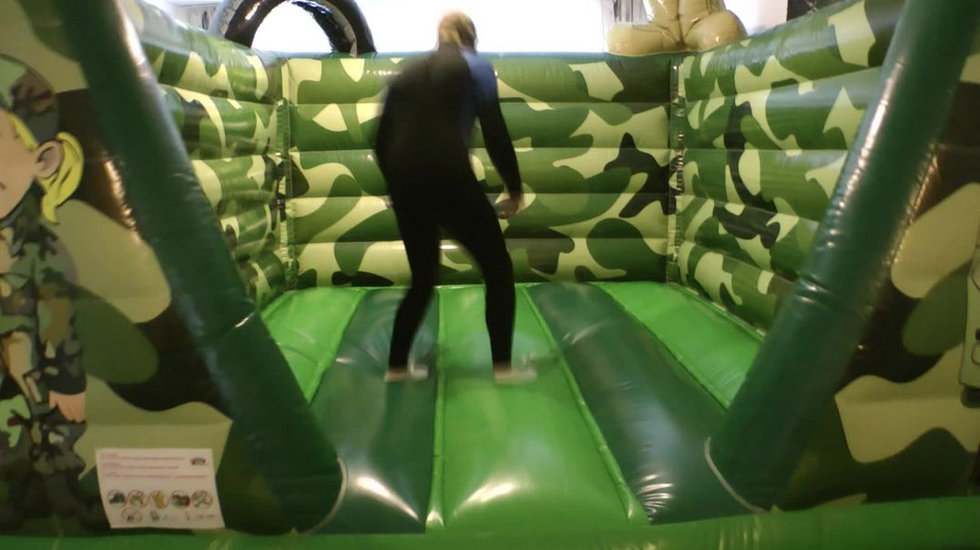 Jumping on my Bouncy Castle with diving suit