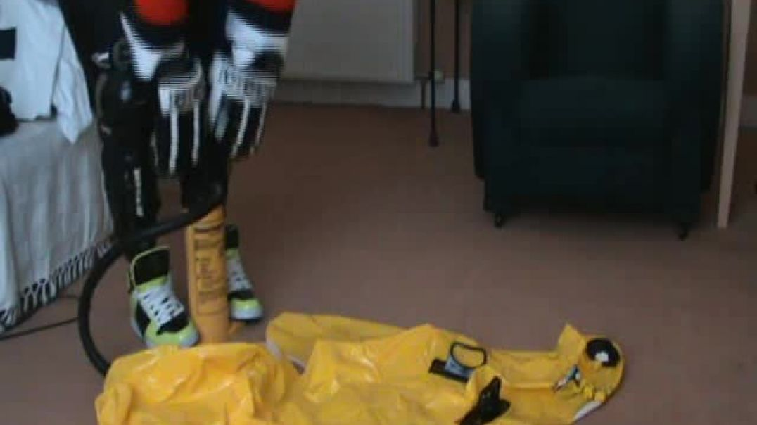 Playing with a Intex seal in  ice hockey gear.