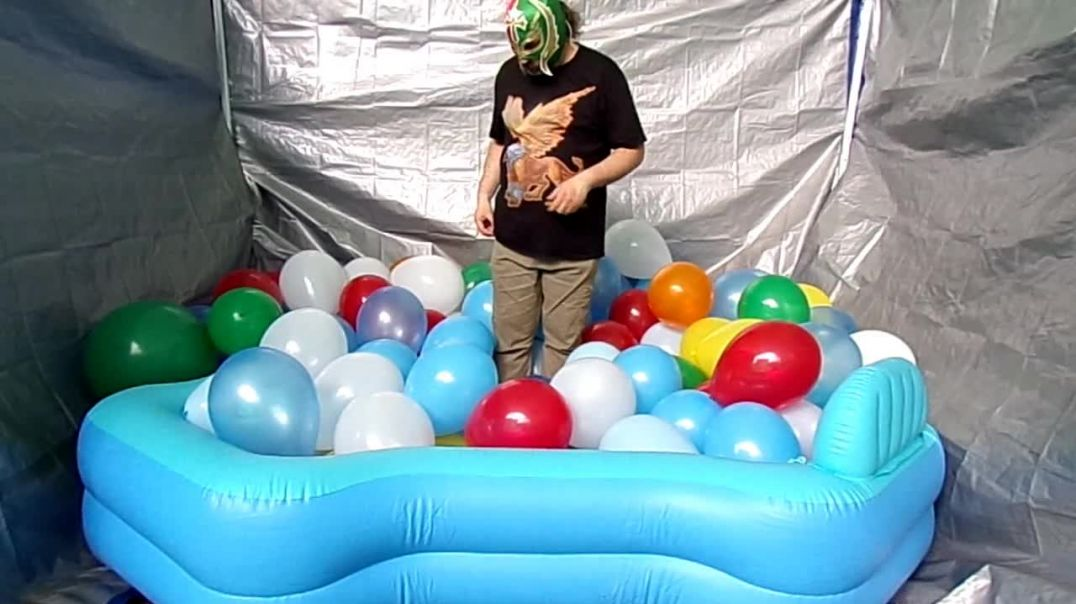 Popping a pool filled with balloons!