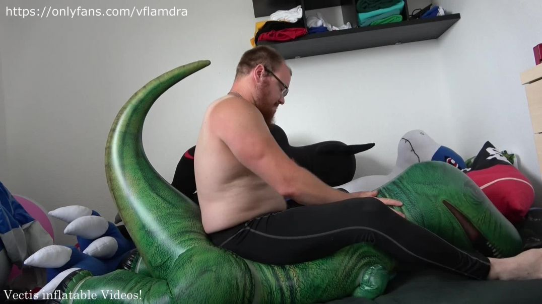 Riding on the inflatable T-rex