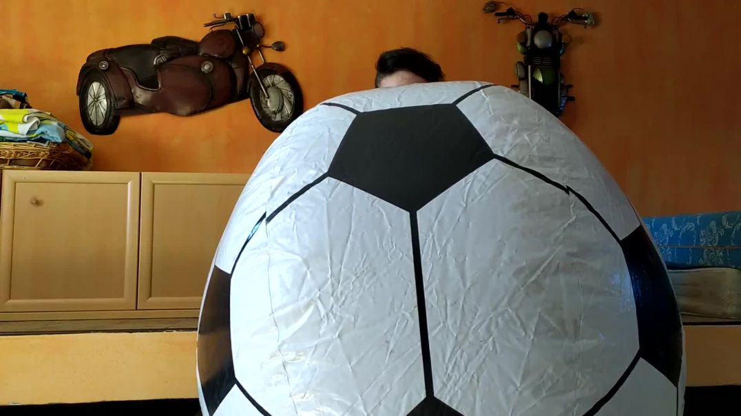 Inflating giant beachball football